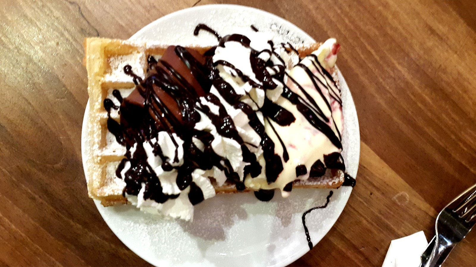 Eating waffle in Rua Augusta Lisbon Portugal
