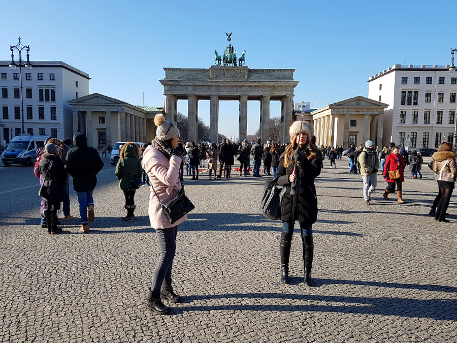 Taking pictures in front of the Brandenburg Gate Berlin.jpg